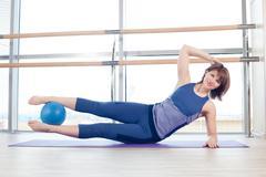 Pilates woman stability ball gym fitness yoga exercises girl Stock Photos