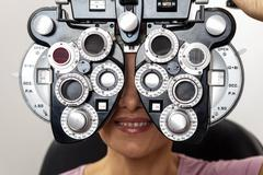 Ophthalmologist performing eye tests - stock photo