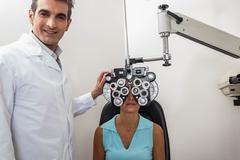Ophthalmologist checking the eyes - stock photo