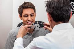 Man looking at the glasses Stock Photos