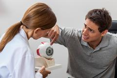 Man worried about the eye Stock Photos