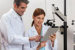 Happy ophthalmologists discussion Stock Photos