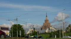 Traffic with the Latvian Academy of Sciences at the background in Riga - stock footage