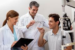 Doctors showing the glasses - stock photo