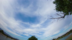 4K UHD fisheye view subtle whispy clouds afteroon sky over lake Stock Footage