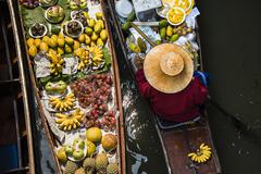 High angle view of merchant selling fruit in canoe Stock Photos