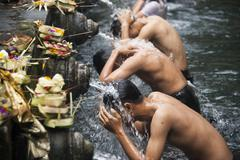 High angle view of men washing in fountains Stock Photos