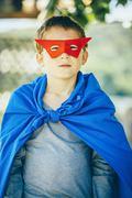 Caucasian boy wearing superhero costume Stock Photos