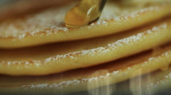 Close up, Honey dripping down a pancake stack Stock Footage