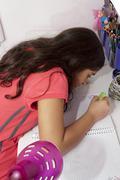 Child in her desk studing Stock Photos