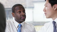 4k, Two businessmen interviewing a candidate or negotiating a deal. Stock Footage