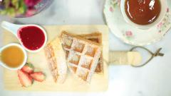 Top view breakfast waffles and hot tea from above Stock Footage