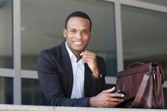 Black businessman using cell phone - stock photo