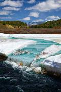 River Chibitka over ice at Spring - stock photo