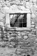 Old window grille of a ruined castle Stock Photos