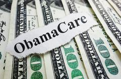 Obamacare money Stock Photos