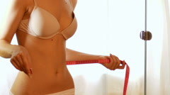 Woman measure her buttocks with a measuring tape Stock Footage