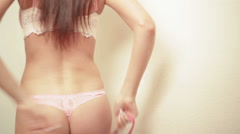 woman measure her buttocks with a measuring tape - stock footage