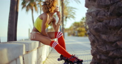 Adorable Roller Skate Girl Sitting at Beach - stock footage