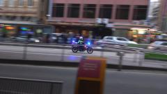 Police motorbike racing through streets Stock Footage