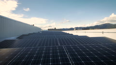 Dolly of Solar Panels on Western Roof - stock footage