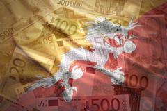 colorful waving bhutan flag on a euro money background - stock photo