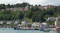 View across River Dart towards Dartmouth Town and Britannia Royal Naval Colle Stock Footage