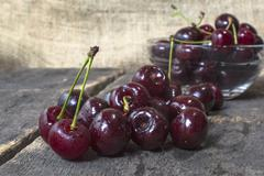 Sweet cherry on table, organic food. - stock photo