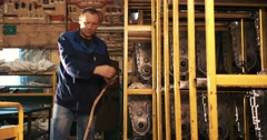 Worker repairing broken motor-block in garage Stock Footage
