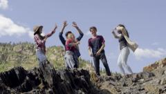 Group Of Teens Break Out Into Dance At The Top Of A Mountain (4K) Stock Footage