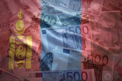 Colorful waving mongolian flag on a euro money background Stock Photos