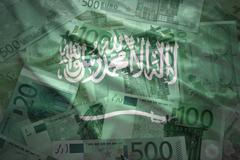 colorful waving saudi arabia flag on a euro money background - stock photo