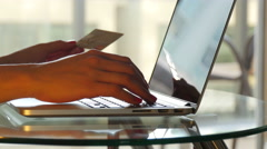 Woman uses a credit card for online shopping Stock Footage