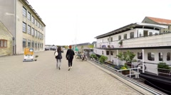 Walking along a canal with houseboats in Copenhagen Stock Footage