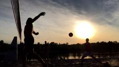 Professional beach volleyball action at sunset. Slow motion. Stock Footage