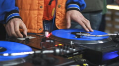 DJ scratching on a disco Stock Footage
