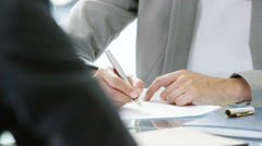 4k,Attractive business woman signing contracts and shaking hands to close a deal - stock footage