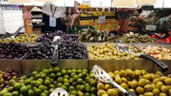 Woman Putting Olives in Container at the Market 4K - stock footage