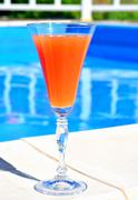 Cocktail on blue pool background Kuvituskuvat