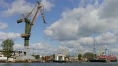 Harbour cranes and shipyard in Gdansk, Poland Stock Footage