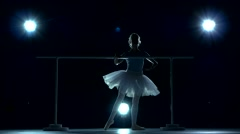Beautiful girl ballet dancer practicing on the barre Stock Footage