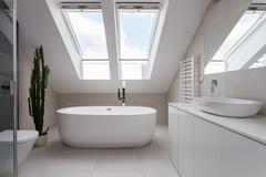 Freestanding bath in white bathroom Stock Photos