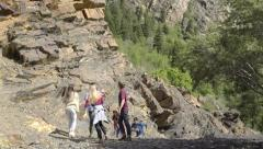 Teens Reach The Top Of Mountain, They Cheer, High Five, Hug And Then Continue Stock Footage