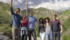 Group Of Wild Teens On A Mountain Top, They Smile, Cheer, Hands In Air (4K) Stock Footage