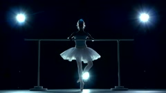 Classic ballet dancer in white tutu posing on handle bar Stock Footage