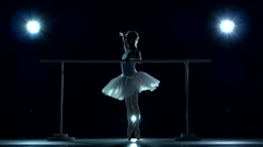 Ballerina is wearing white tutu and pointe shoes Stock Footage