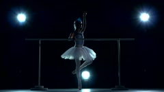 A beautiful female ballet dancer. Silhouette Stock Footage