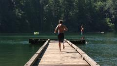 Kids Running And Jumping Into Lake - stock footage