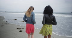Beautiful women standing by the ocean Stock Footage