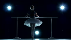 Ballerina in white tutu makes you lean forward. back view Stock Footage